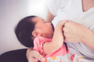 Mother Breastfeeding Baby Girl
